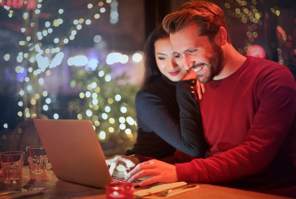 Couple researching into wedding suppliers